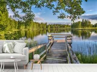 Pier with wooden benches at the lake in Lapland