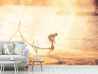 Silhouette and vintage color styl showing flyboard on Chaophya river