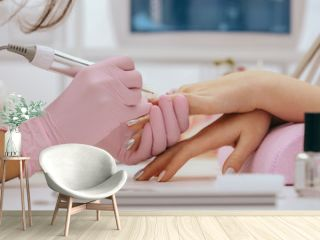 Manicurist with a milling cutter for manicure
