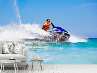 Teenager on water scooter. Teen age boy water skiing.