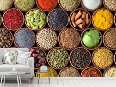 Different seasonings in cups. Spice background on the table