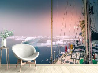 Greenland, arctic: sailing boat trough the iceberg, risk, danger