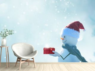 Merry christmas and happy new year greeting card . Happy snowman  standing in winter christmas landscape.