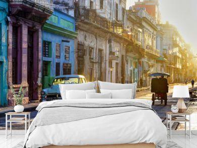 Street scene in Old Havana (La Habana Vieja), classic car, bicitaxi and people going to work, Cuba