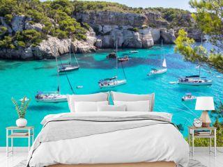 Boats and yachts on Macarella beach, Menorca, Spain