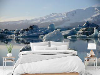 the glacier lagoon Jökulsarlon in Iceland with floating icebergs.
