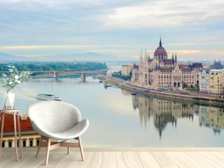 Quite Danube river, floating cruise ship, Parliament building. Budapest, Hungary