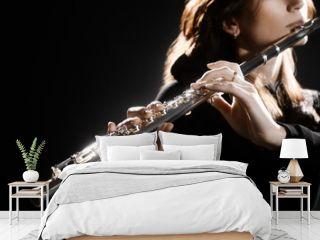 Flute instrument. Flutist hands playing flute music