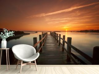 old sea pier at sunrise