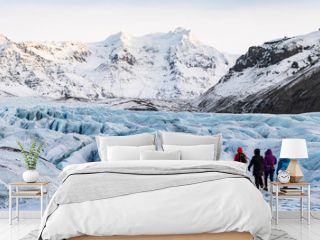 mountaineers hiking a glacier