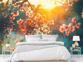 Spring blossom background. Nature scene with blooming tree and sun flare. Spring flowers. Beautiful orchard