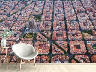Aerial view of Barcelona Eixample residencial district and Sagrada familia, Spain. Late afternoon light