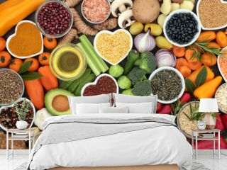 Food for good health and fitness concept with fruit, vegetables, pulses, grains, herbs, spices, nuts, seeds, olive oil & himalayan salt.  High in antioxidants, smart carbohydrates & anthocyanins.