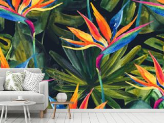 Watercolor tropical seamless pattern with bird-of-paradise flower, monstera, palm leaf.