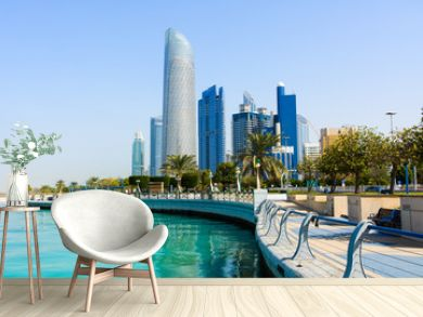 Modern buildings of downtown Abu Dhabi view from the walking area by the seaside