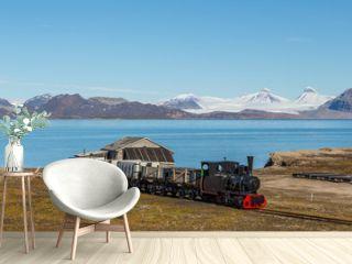 old industrial train in Ny Alesund, Spitzbergen, Svalbard, blue sky