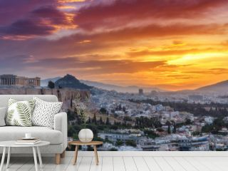 Panorama view on Acropolis in Athens, Greece, at sunrise. Scenic travel background with dramatic sky.