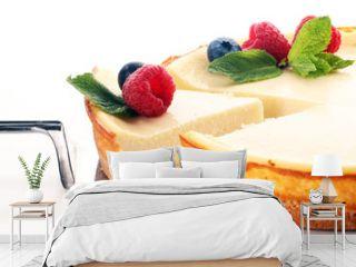 Homemade cheesecake with fresh raspberries and mint for dessert - healthy organic summer dessert pie cheesecake. Vanilla Cheese Cake