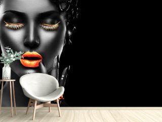 Fashion model, golden lips, eyelashes and jewellery - golden ring on hand. Isolated on black background. Beauty woman face, beautiful make-up. Gorgeous lady fashion art portrait.