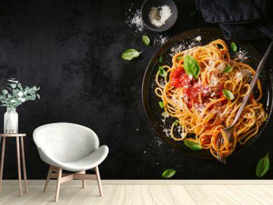 Dark plate with italian spaghetti on dark