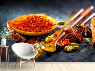 Saffron. Various Indian Spices on black stone table. Spice and herbs on slate background. Cooking ingredients