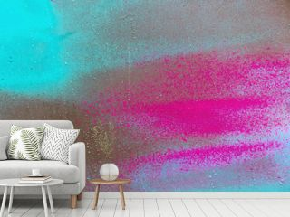 Colorful spray paint splatters on the wall