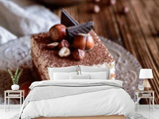 Chocolate sponge cake with hazelnut and whipped cream layers, topped with cocoa powder
