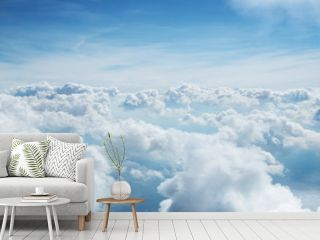 Blue sky and clouds background with lots of copy space.