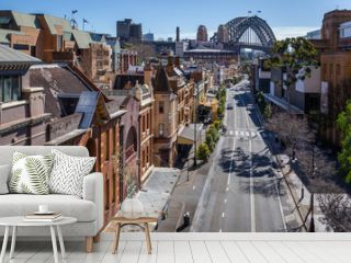 View of George Street in the Rocks, the historic district of Sydney. In the background, the harbour Bridge.