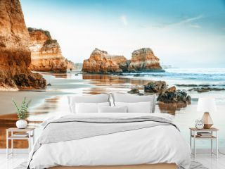 beautiful ocean landscape, the coast of Portugal, the Algarve, rocks on the sandy beach, a popular destination for travel in Europe