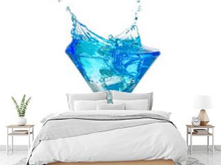 blue cocktail splashing out of a glass isolated on white background