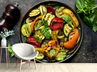Grilled vegetables (  colorful bell pepper, zucchini, eggplant ) with basil and dry herbs.Top view.