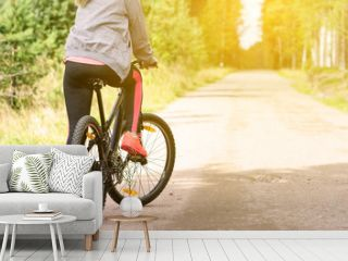 Woman with a mountain bicycle
