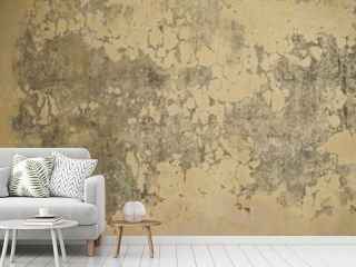 Faded yellow ancient crumbling plaster stucco wall horizontal background
