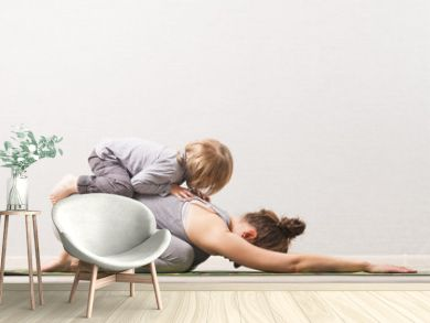 woman mom practicing yoga with her child