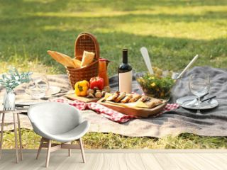 Blanket with food prepared for summer picnic outdoors