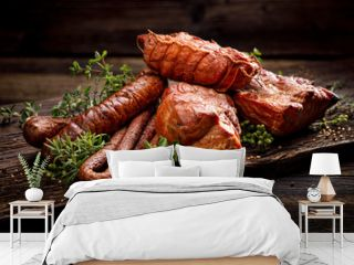 Smoked meats and sausages. A set of traditional smoked meats and sausages: ham,gammon, pork loin, home-style sausages, kabanosy. Traditional meats and sausages smoked in apple, beech and juniper wood