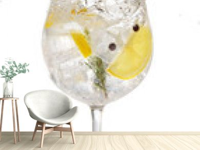 gin tonic garnished with lemon and rosemary splashing on white background