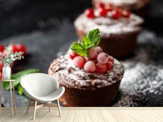 Classic chocolate fondant on a dark background. Chocolate muffins
