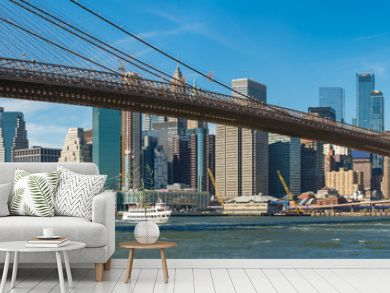 Panoramic view of Brooklyn bridge over Manhatten skyscrapers in New York.