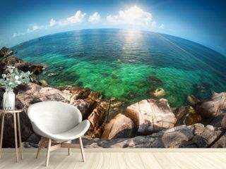 Seascape fisheye view on tropical sea with a huge stones