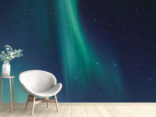 Northern lights and stars on the night sky. Murmansk region, Russia