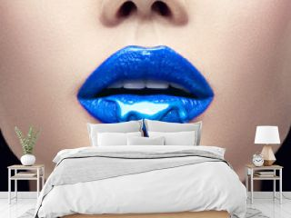 Blue lipstick dripping. Lipgloss dripping from sexy lips, Blue liquid drops on beautiful model girl's mouth, creative abstract makeup