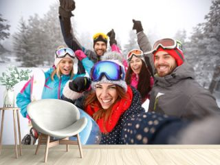 Friends with hands up on skiing