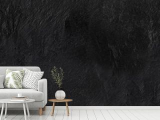 A seamless pattern of an abstract black slate background, a dark texture with a place for text, a stone repeat print