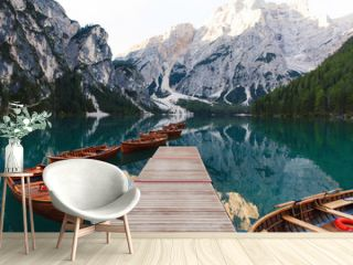 Beautiful landscape of Braies Lake (Lago di Braies), romantic place with wooden bridge and boats on the alpine lake, Alps Mountains, Dolomites, Italy, Europe