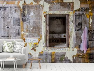 Wall plastered with old Soviet newspapers at abandoned military hospital complex