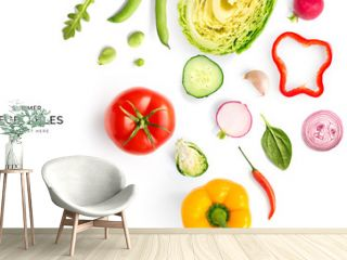 Creative layout made of summer vegetables. Food concept. Tomatoes, onion, cucumber, green peas, garlic, cabbage, chilly pepper, yellow pepper, salad leaves and radish on white background.