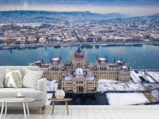 Budapest, Hungary - Aerial view of the Parliament of Hungary at winter time with snowing