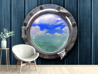 Ship porthole with wooden wall and ocean view
